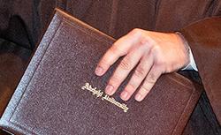 Hand on Adelphi Diploma